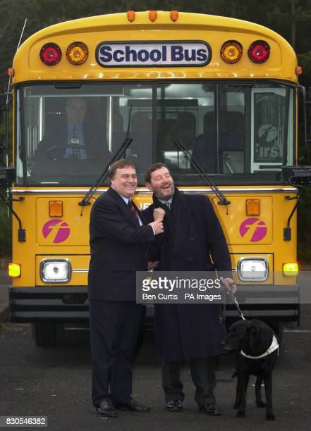Deputy Prime Minister John Prescott and Education Secretary David Blunkett stand by an Americanstyle school bus outside the Labour Spring Conference...