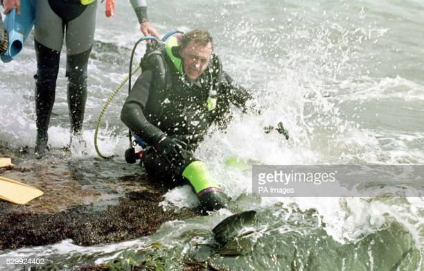 Deputy Prime Minister John Prescott is nearly swept away by a giant wave as he took the plunge and went diving off the coast of Northumberland today...