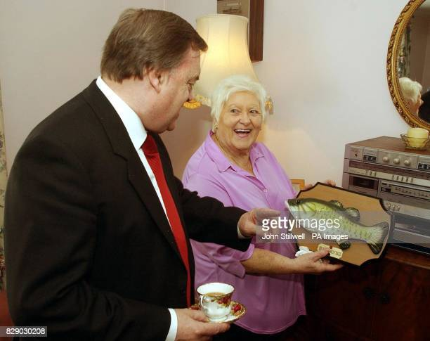 Deputy Prime Minister John Prescott is shown Molly Hammond's 'Billy Bass' singing fish as he visits Molly's council flat in Chelsea West London as...