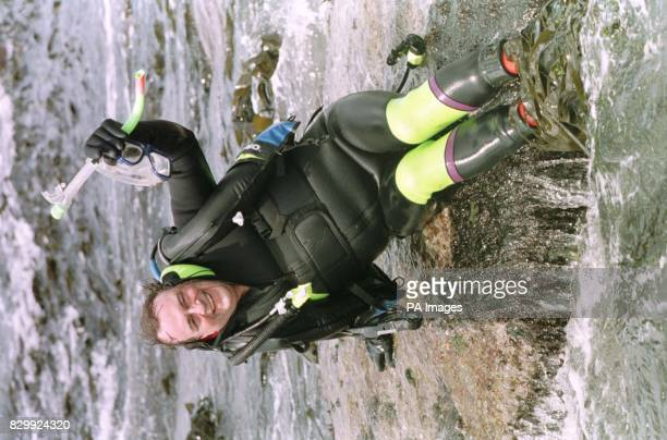 Deputy Prime Minister John Prescott poses before nearly being swept away by a giant wave as he took the plunge and went diving off the coast of...