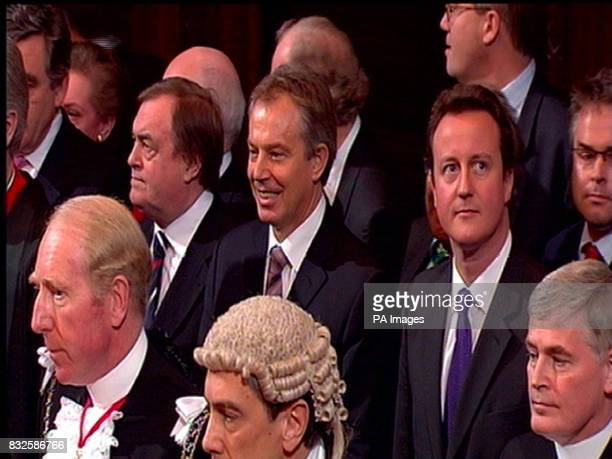 Deputy Prime Minister John Prescott Prime Minister Tony Blair and Conservative party leader David Cameron stand before listening to the Queen's...