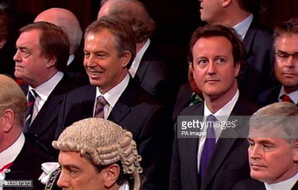 DISTORTION Deputy Prime Minister John Prescott Prime Minister Tony Blair and Conservative party leader David Cameron stand before listening to the...