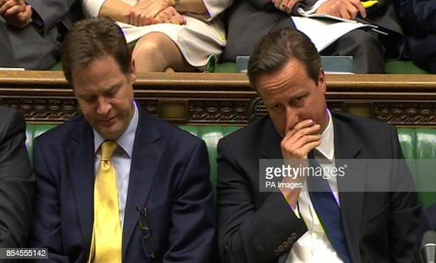 Deputy Prime Minister Nick Clegg and Prime Minister David Cameron listen as leader of the opposition Ed Miliband speaks during a debate on the...