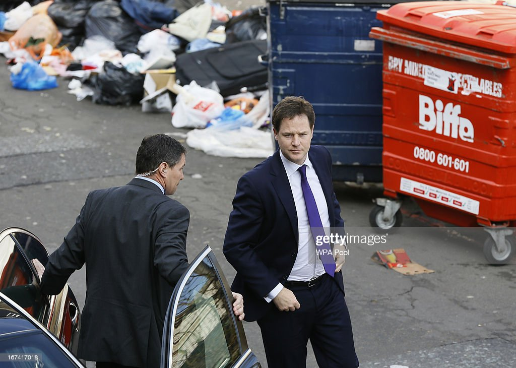 Deputy Prime Minister, Nick Clegg arrives in Rumsey Road which is littered with rubbish as he visits the Stockwell Park Estate on April 25, 2013 in in London, England. The Deputy Prime Minister and Jeremy Browne, Minister for Crime Prevention met with police, residents and community workers to see how crime is tackled in the area.