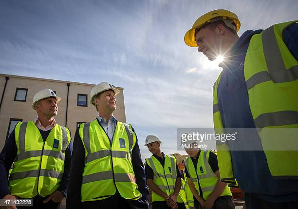 Deputy Prime Minister Nick Clegg chats with an apprentice as he visits the new Bath Riverside Crest Nicholson development as he canvasses with...