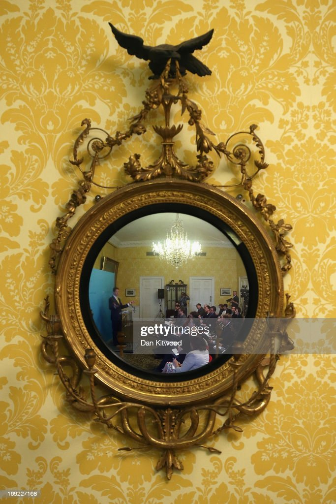 Deputy Prime Minister Nick Clegg is reflected in a mirror while speaking during a press conference at Admiralty House on May 22, 2013 in London, England. Mr Clegg spoke to members of the media about his Liberal Democrat party and the coalition with the Conservative party ahead of the next general election in 2015.