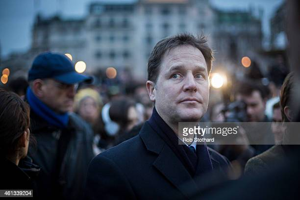 Deputy Prime Minister Nick Clegg joins crowds gathered in Trafalgar Square to show their respect to victims of the terrorist attacks in Paris on...