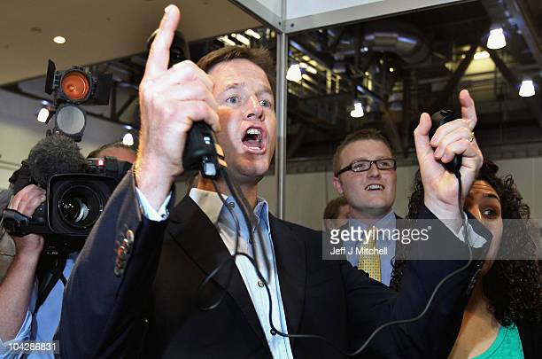 Deputy Prime Minister Nick Clegg plays on a Wii video game console as he tours the stalls at the Liberal Democrat Conference in the ACC Liverpool...