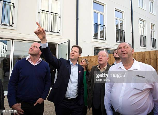 Deputy Prime Minister Nick Clegg points to a building as he chats with Liberal Democrat supporters as he visits the new Bath Riverside Crest...