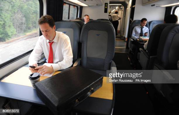 Deputy Prime Minister Nick Clegg works on the 1700 Acela Express train from Washington DC to New York City after having lunch with US Vice President...