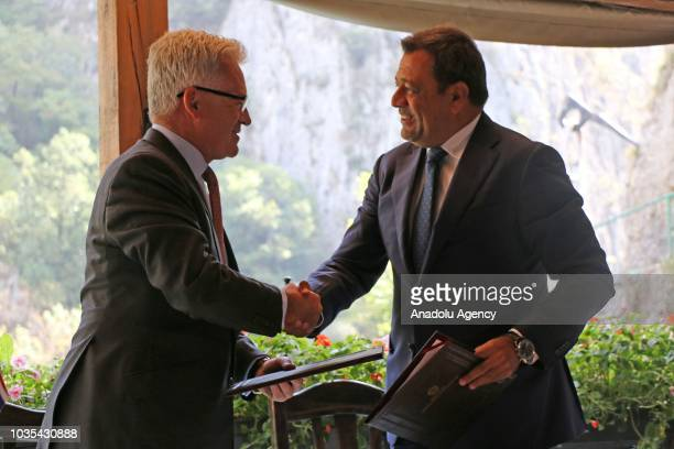 Deputy Prime Minister of Macedonia responsible for economic affairs and coordination with the economic sectors Koco Angjushev shakes hands with...
