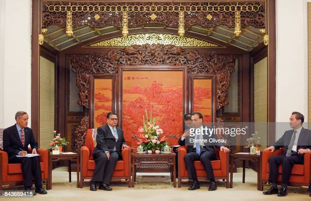 Deputy Prime Minister of Nepal Krishna Bahadur Mahara attends a meeting with Chinese Premier Li Keqiang and Chinese Foreign Minister Wang Yi at...