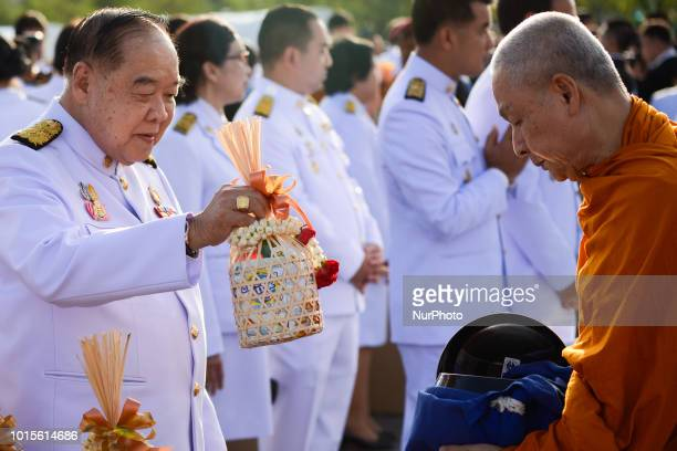 Deputy Prime Minister Prawit Wongsuwan gives alms to Buddhist monks to celebrate the Queen Sirikit's 86th birthday in Bangkok Thailand 12 August 2018