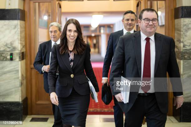 Deputy Prime Minister Winston Peters, Prime Minister Jacinda Ardern, Greens leader James Shaw and Finance Minister Grant Robertson walk to the house...