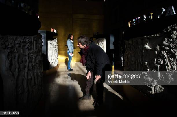 Deputy Rome Mayor Luca Bergamo looks at an exhibit during the presentation of the archeological exhibition on the roman emperor Trajan on November 28...