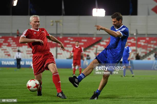Deputy Secretary General Zvonimir Boban shoots and scores during the FIFA Football Tournament at the Bahrain National Stadium ahead of the 67th FIFA...