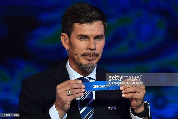 Deputy Secretary General Zvonimir Boban shows the name of Germany during the draw for the 2017 FIFA Confederations Cup at the tennis academy center...