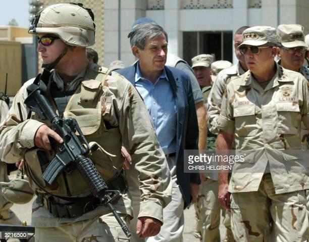 US Deputy Secretary of Defense Paul Wolfowitz tours Iraq's Abu Gharib prison on the outskirts of the capital Baghdad 20 July 2003 AFP PHOTO/POOLChris...