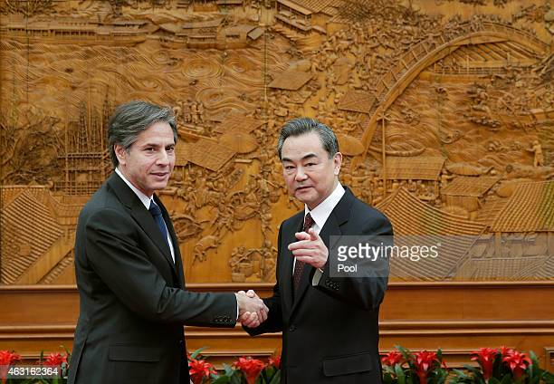 Deputy Secretary of State Antony Blinken shakes hand with Chinese Foreign Minister Wang Yi at the Olive Hall before a meeting at the Foreign Ministry...