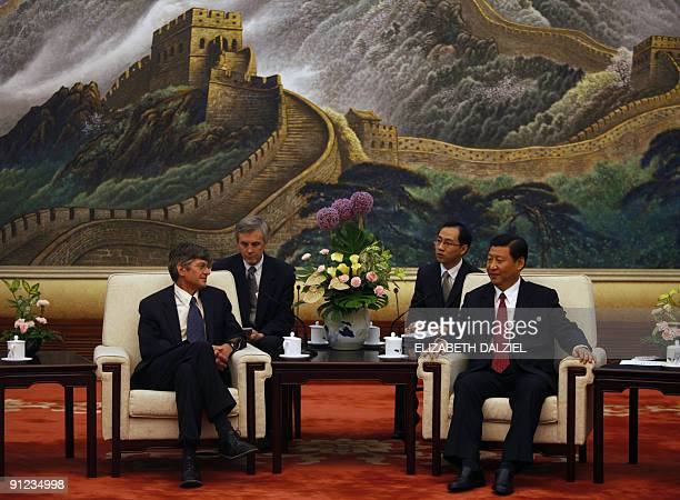 US Deputy Secretary of State James Steinberg speaks with Chinese Vice President Xi Jinping during their meeting at Zhongnanhai in Beijing on...