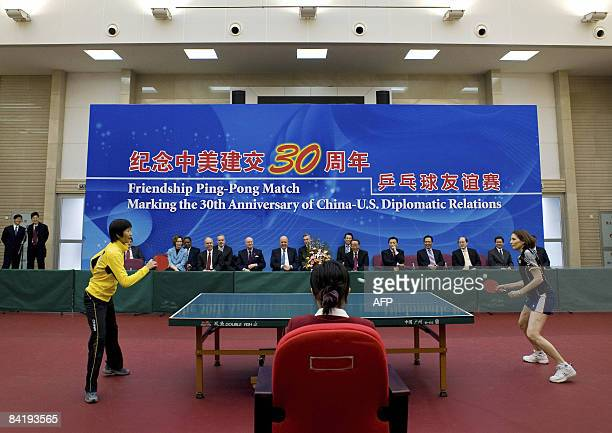 Deputy Secretary of State John Negroponte and China Vice Foreign Minister Wang Guangya watch a commemorative table tennis match marking China's...