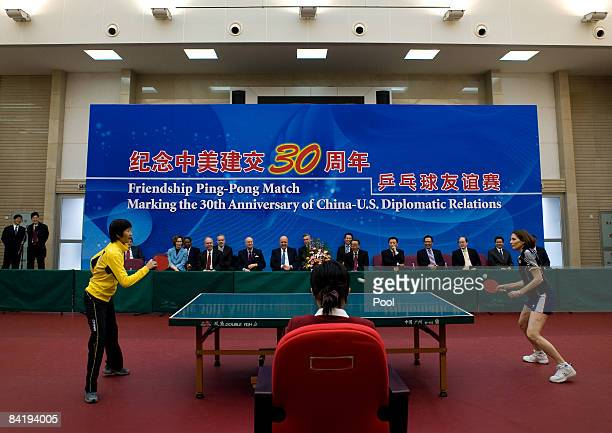 S Deputy Secretary of State John Negroponte center left and China Vice Foreign Minister Wang Guangya center right watches a table tennis games play...