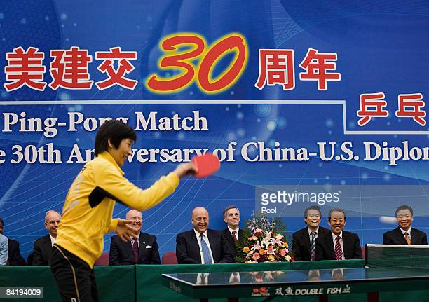 Deputy Secretary of State John Negroponte, center left, and China Vice Foreign Minister Wang Guangya, center right, watches a table tennis games play...