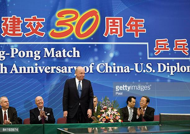 Deputy Secretary of State John Negroponte, center, stands when Chinese introducing him and Vice Foreign Minister Wang Guangya, right, look on as they...