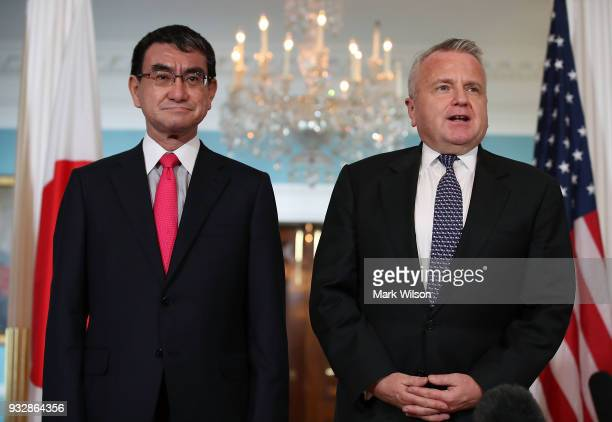 S Deputy Secretary of State John Sullivan greets Japanese Foreign Minister Taro Kono before a meeting at the State Department on March 16 2018 in...