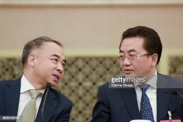 Deputy Secretary of the Sichuan CPC Provincial Committee Deng Xiaogang talks with a Member of the Standing Committee of Sichuan Province Fan Ruiping...