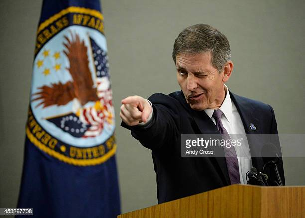 Deputy Secretary of Veterans Affairs Sloan Gibson points to where he previously spoke to a veteran earlier in the day during a press conference at...