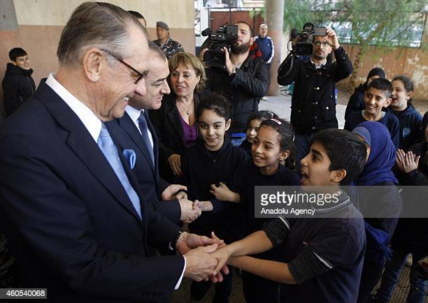 Deputy SecretaryGeneral Jan Eliasson and Lebanese Education Minister Elias Bou Saab cuddle up with children at a school for Syrian child refugees in...