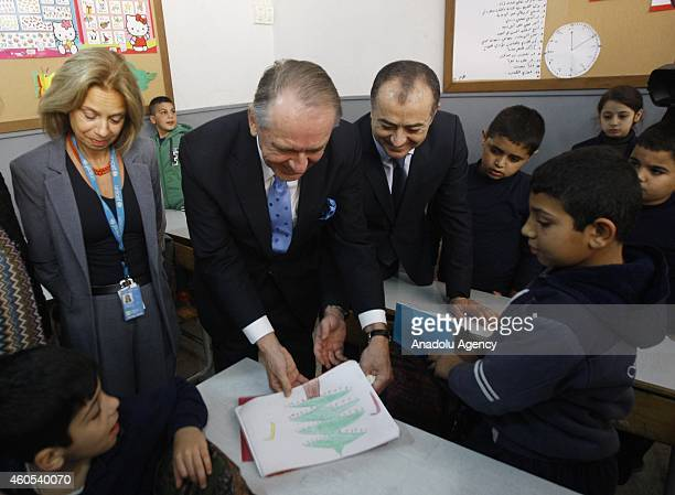 Deputy SecretaryGeneral Jan Eliasson and Lebanese Education Minister Elias Bou Saab look a painting of a student at a school for Syrian child...
