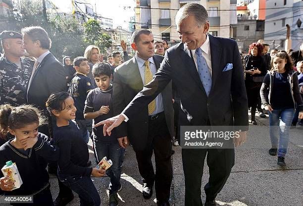 Deputy SecretaryGeneral Jan Eliasson greets the children at a school for Syrian child refugees in the Bourj Hammoud area northern Beirut Lebanon on...
