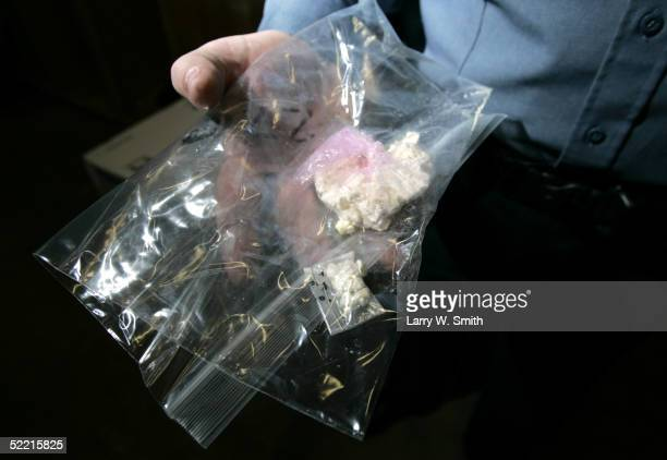 Deputy Sheriff Kirk Ives holds two examples of methamphetamine taken on a bust in the evidence room on February 18 2005 at the Pratt County Sheriffs...