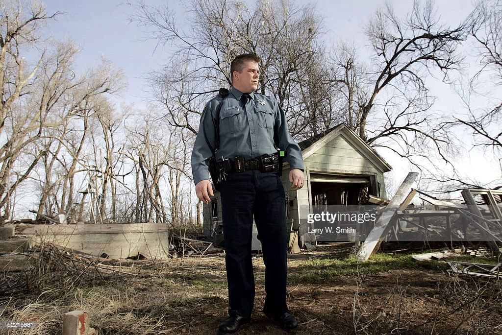 Deputy Sheriff Kirk Ives looks around outside a small abandoned building on February 18, 2005 for leftover items used in the production of methamphetamine while he patrols the rural areas near Pratt, Kansas. The Pratt County Sheriff's Office has over 700 square acres of rural land to patrol on a daily basis looking for any kind of methamphetamine substances such as trash or labs.