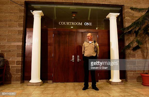 Deputy Sheriff stands guard outside the district courtroom where NBA star Kobe Bryant will stand trial. LA Lakers guard Bryant entered no formal plea...