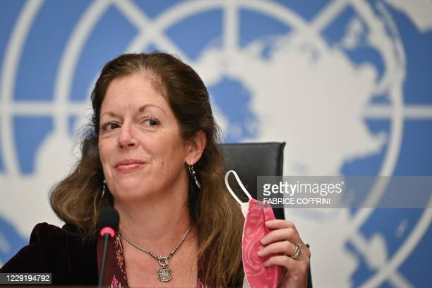 Deputy Special Representative of the UN Secretary-General for Political Affairs in Libya Stephanie Williams removes her protective face mask during a...