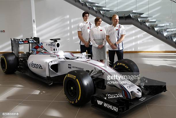 Deputy Team Principal Claire Williams Canadian driver Lance Stroll and Finnish driver Valtteri Bottas pose for a photograph following the...