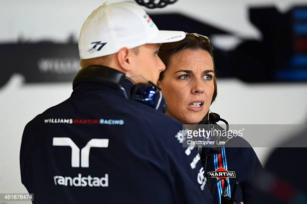 Deputy team principal Claire Williams speaks with Valtteri Bottas of Finland and Williams in the garage during practice ahead of the British Formula...