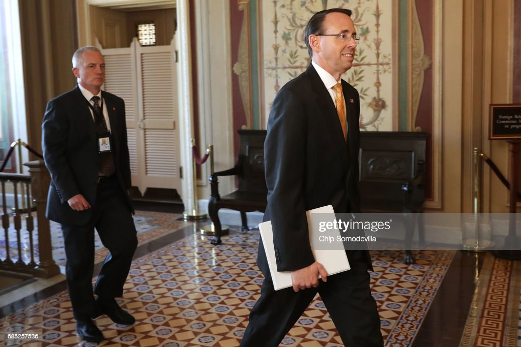 Deputy U.S. Attorney General Rod Rosenstein (R) leaves the U.S. Capitol following a closed-door briefing with members of the House of Representatives May 19, 2017 in Washington, DC. Rosenstein met with senators a day earlier and was questioned about his role in the firing of former FBI Director James Comey and his appointment of former FBI Director Robert Mueller as a special counsel to investigate Russian meddling in the 2106 presidential election.