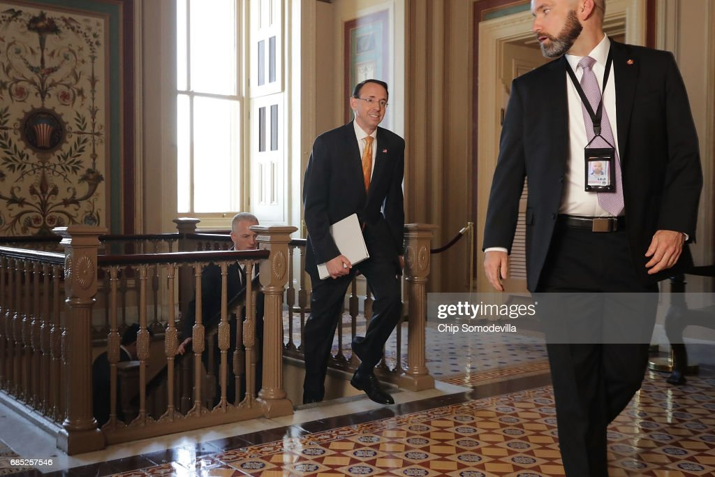 Deputy U.S. Attorney General Rod Rosenstein (C) leaves the U.S. Capitol following a closed-door briefing with members of the House of Representatives May 19, 2017 in Washington, DC. Rosenstein met with senators a day earlier and was questioned about his role in the firing of former FBI Director James Comey and his appointment of former FBI Director Robert Mueller as a special counsel to investigate Russian meddling in the 2106 presidential election.