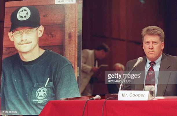 Deputy US Marshal Larry Cooper testifies 15 September before the Senate subcommittee investigating the FBI siege at Ruby Ridge Idaho with a photo of...