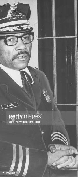 Deputy Warden Gary Smith sitting at night at Baltimore City Jail during the aftermath of a riot Baltimore Maryland March 3 1973