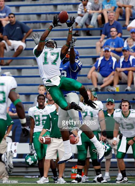 DeQuan Bembry of the Marshall Thundering Herd makes an interception over Duke Calhoun of the Memphis Tigers on September 26, 2009 at Liberty Bowl...