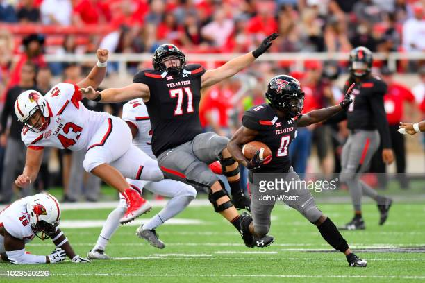 De'Quan Bowman of the Texas Tech Red Raiders carries the ball during the game against the Lamar Cardinals on September 08 2018 at Jones ATT Stadium...