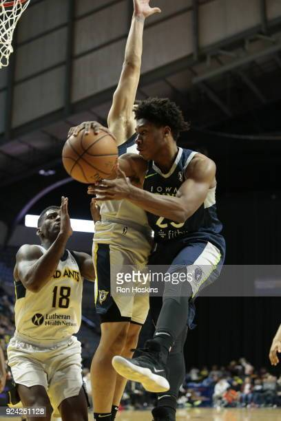 DeQuan Jones and Stephan Hicks of the Fort Wayne Mad Ants battle Marquise Moore of the Iowa Wolves on February 25 2018 at Memorial Coliseum in Fort...