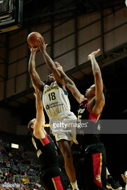 Dequan Jones of the Fort Wayne Mad Ants battles Chris McCullough of the Erie Bayhawks in the 2018 Eastern Conference semifinals of the NBA G League...