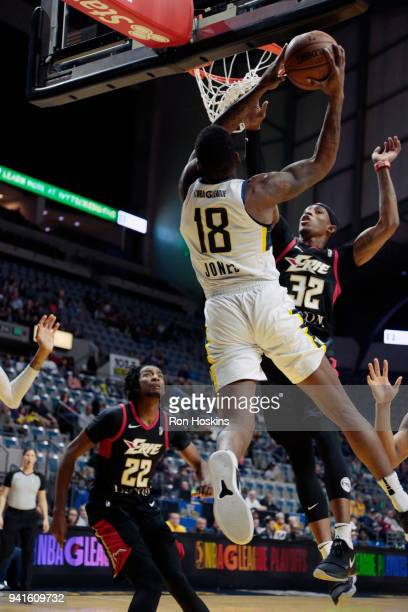 DeQuan Jones of the Fort Wayne Mad Ants battles Craig Sword of the Erie Bayhawks in the 2018 Eastern Conference semifinals of the NBA G League on...
