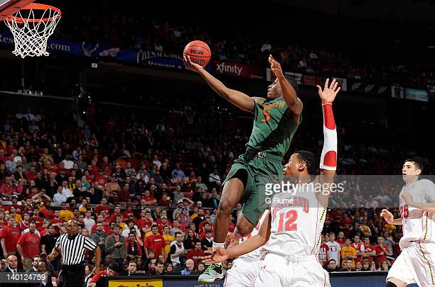 DeQuan Jones of the Miami Hurricanes drives to the hoop against Terrell Stoglin of the Maryland Terrapins at the Comcast Center on February 21 2012...